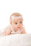 Vertical shot of adorable baby girl looking away Royalty Free Stock Image