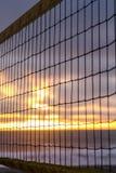 Beach Volley Ball net at sunset Stock Photos