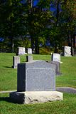 Blank Tomb Stone. Vertical shot of a blank tombstone in a cemetery Royalty Free Stock Image