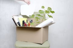 Close up of employee`s box with his stuff,blank speech bubble.Concept of What the worker is thinking during the first moment after stock image
