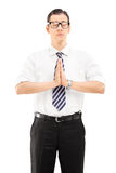 Vertical shot of a calm businessman meditating Stock Photography
