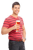 Vertical shot of a casual guy drinking beer Stock Photo