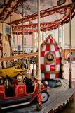 Vertical shot of a colorful carousel captured in Menton, French Riviera, France
