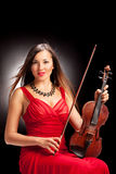 Vertical shot of a female violinist posing Royalty Free Stock Photos
