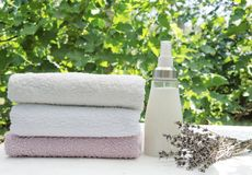 Vertical Shot.Fresh Washed Soft Towels.Bottle Of Lavebder Softener And Clean Towels Outdoor Stock Image