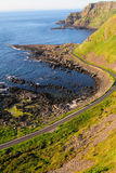 Vertical shot of Giant's Causeway cliffs Stock Images
