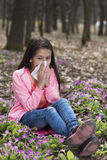 Vertical shot of girl blowing her nose. Allergy Stock Photo