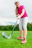 Vertical shot girl golfer Stock Photography