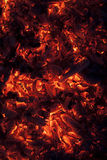 Vertical shot of glowing embers in hot red color Royalty Free Stock Photos