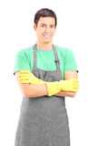 Vertical shot of a male housekeeper posing Royalty Free Stock Photo