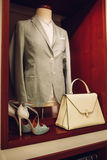 Vertical shot of mannequin with woman`s suits, high heeled shoes and a handbag Stock Photo