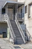 Metal Staircase Behind an Industrial Building. Vertical shot of a metal staircase behind an industrial building Stock Images