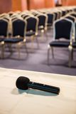 Vertical shot of microphone and auditorium Stock Image