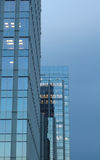 Vertical Shot Of A Glass Office Building Stock Photo