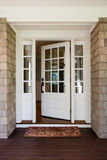 Vertical shot of an open, wooden front door Stock Image