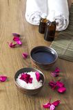 Vertical shot. Preparation for massage therapy. Bowls with cosmetic goods and petals making relax mood royalty free stock photography