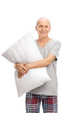 Vertical shot of a senior hugging a pillow Royalty Free Stock Images