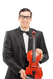 Vertical shot of a young musician posing with a violin Stock Photos