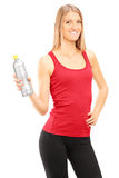 Vertical shot of a young woman holding a water bottle Stock Photos