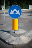 Vertical signal near roundabout on the street Royalty Free Stock Photos