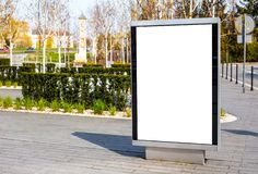 Vertical small billboard in the city on the sidewalk. Mock up for advertising or announcements stock images