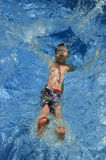 Vertical Splash. Boy falling into pool Stock Images