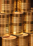 Vertical stack of golden metal food can background Royalty Free Stock Image