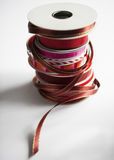 Vertical stack of holiday ribbon spools royalty free stock image