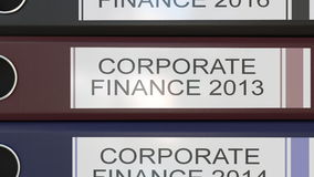 Vertical stack of multicolor office binders with Corporate finance tags 3D rendering different years Stock Images