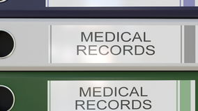 Vertical stack of multicolor office binders with Medical records tags