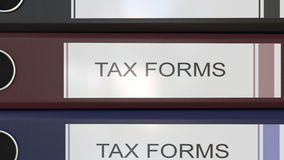 Vertical stack of multicolor office binders with Tax forms tags 3D rendering. Vertical stack of multicolor office binders with Tax forms tags Royalty Free Stock Photography