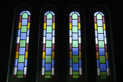 Vertical stained glass windows of the cathedral. The colorful vertical stained glass cathedral. Backlit the four featured in windows Stock Photo