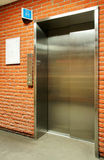 Vertical steel door elevator Royalty Free Stock Image
