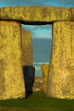 Vertical Stonehenge Blocks at Dusk. A single section of Stonehenge blocks in the evening sun with pale blue clouds and grass royalty free stock photos