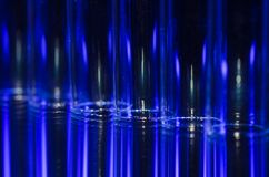 Vertical Streaks of Blue and White Light Forming a Fascinating Background Royalty Free Stock Photo