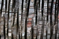 Vertical strips of chopped wood as a background Stock Photo