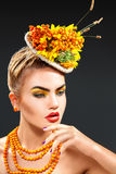 Vertical studio portrait of fashion model with rowan bouquet Stock Photography