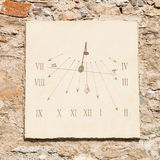 Vertical sundial made of  carved stone's slab  and  iron rod Stock Photos