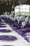 Vertical Table Setting for Wedding, Purple. Table set for Texas wedding reception with purple and white decor and crystal wine glasses Stock Photography