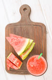 Vertical take watermelon and juice on wood Royalty Free Stock Photos