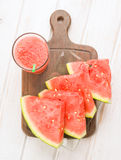 Vertical take watermelon and juice on wood Royalty Free Stock Image