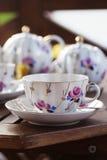 Vertical tea set on terrace Royalty Free Stock Photos