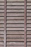 Vertical texture of a wall from several rows of brown old wooden boards. Painted wooden wall in brown colo. R royalty free stock images