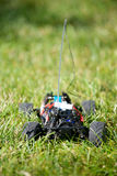 Vertical of toy RC truck in grass, no body Royalty Free Stock Photo