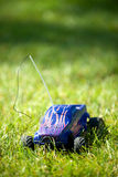 Vertical of toy RC truck in grass. No shade Stock Photography