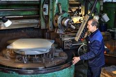 Vertical turret lathe machine,  tool operator controls processin Royalty Free Stock Image