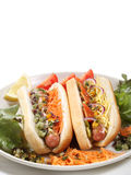 Vertical two hot dogs isolated on white Stock Images