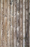 Vertical uncolored weathered gray wooden wall Royalty Free Stock Photo