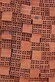 Vertical uneven flow of red bricks for construction. Textural background royalty free stock photography
