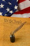 Vertical United States Constitution, Quill Pen in Inkwell, and Flag royalty free stock photography